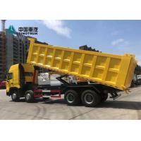 Wholesale 420HP 8X4 29CBM T7H Sinotruk Howo Dump Truck Yellow from china suppliers