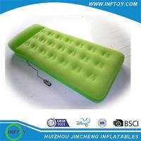 Green inflatable air mattress with pillow