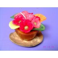 flower candle on coconut shell